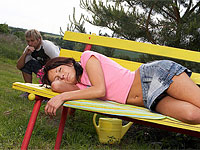 Tiny teenage brunette gets stuffed hard on a park bench