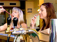 Two horny girlies sharing a stiff bartending cock at work