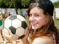 Two teenage girls playing some dirty soccer games outdoor