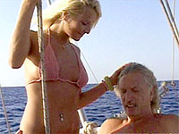 Blonde babe pleasing two wealthy old cocks on their boat