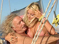 Blonde babe fucking two seniors on their big boat on the sea