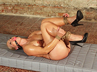 Oiled blonde slave Veronica gets ballgagged and tit-grabbed