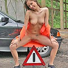 Petite teen girl doing traffic control completely naked from Club Seventeen