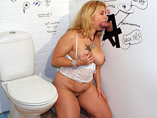 Chubby blonde slut enjoys some gloryhole cock sucking action from Holey Fuck