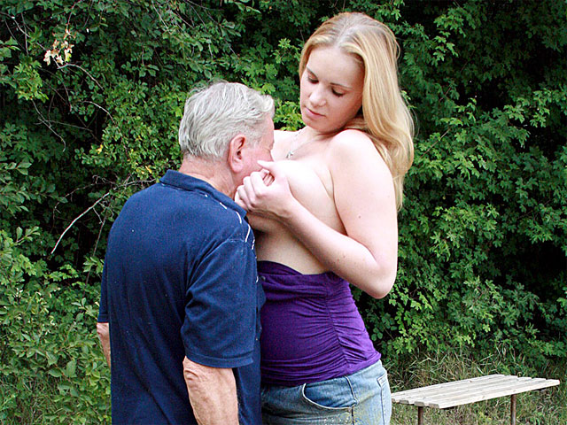 Lizzy is in the forest, basking in the sunshine when she notices a funny old man who is peeking at her from the bushes. Without any ado she decides to punish she pervert by first smothering him with her knockers and right after banging him to near death!