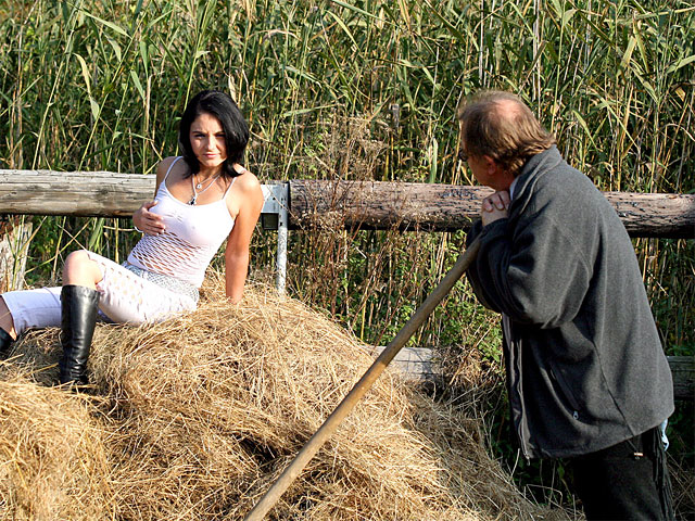 A guy is shifting hay and a horny schoolgirl fine girl is watching him. They get into an argument but then the fine girl seduces him, gives him a blow job and they fuck in the hay. After that he rolls her, still naked, away in a wheelbarrow.