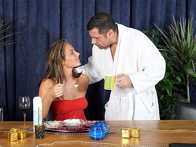 An older guy comes down to the dining room in the middle of the night where his sweetheartfriend is having a late snack of cherries and whipped cream. the feeds her some of the stuff and after that bares her Boobs. The both of them cover each other with the whipping cream in order to lick it off before they fuck.