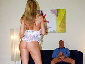 A guy is sitting on a comfy couch talking to the camera. A not very old Babe sits next to him and shows herself off. when she lifts up her outfit she is naked underneath. the slut gives she a blow job and after that sits down on his lap to be fucked over in the ass.