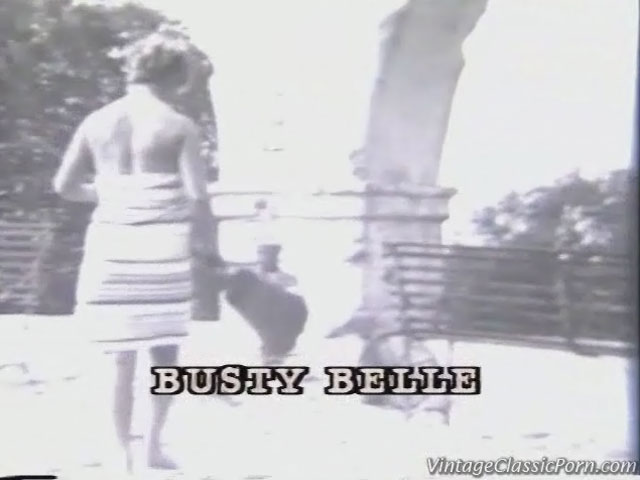 In this vintage silent movie a blond girl with very large boobs is sweeping the street. She is wearing a striped dress that she takes off to show her naked body especially her enormous tits.