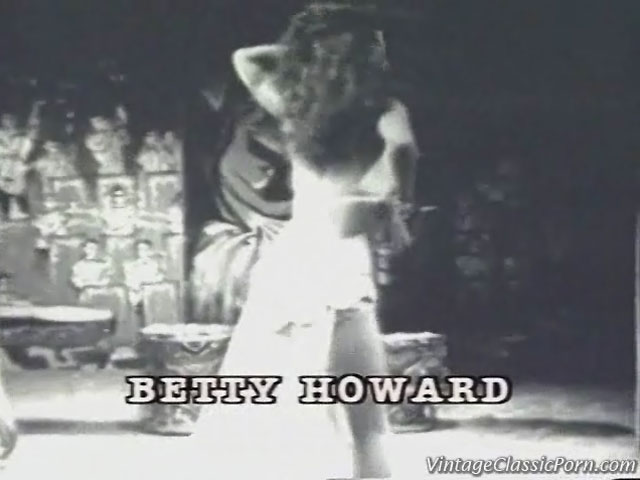 In this classic piece of film we see Betty Howard dancing to jazz music. She is wearing the outfit of a harem girl and while she dances she removes her clothing bit by bit until she is wearing only a bikini.