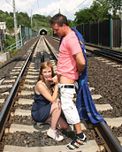 Couple waiting for a train