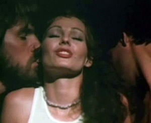 Annette Haven - Annette Haven giving double handjob to 2 guys