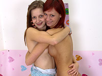 Young girls make love. Exciting naughty young chicks licking and kissing eachother