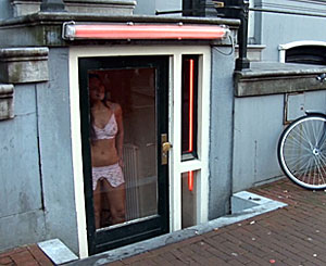 Michael. Sexy tourist fucks this Amsterdam street girl behind her window