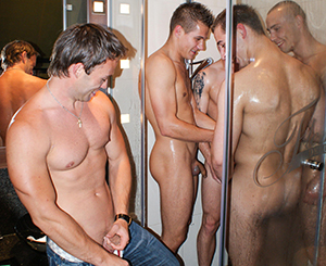 Hotel orgy. Horny young guys in one hotel room get hardcore together