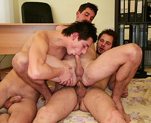 Handsome gay gets mouth and analy stuffed with two huge dicks.